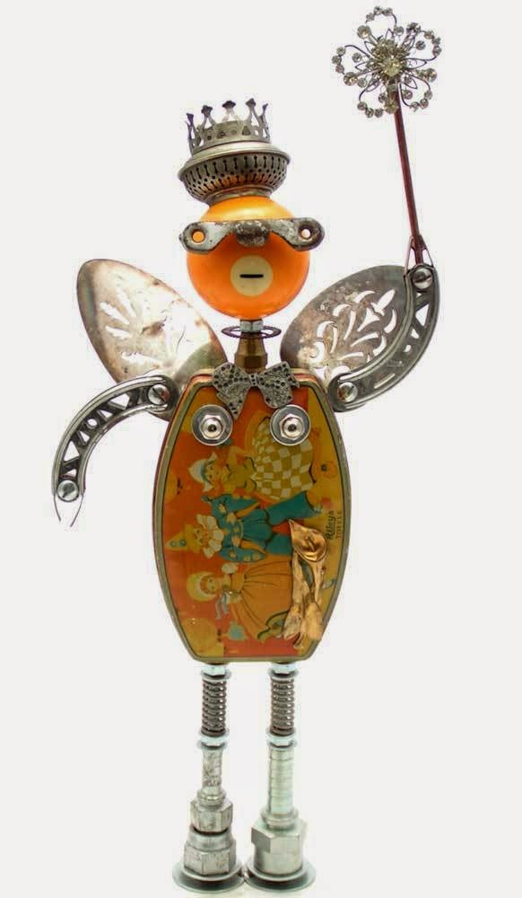 "A ""robot"" with crown, scepter and fairy wings, constructed from found objects"