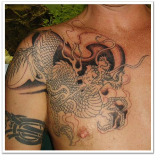 Tattoos for men on chest to shoulder for Shoulder and chest tattoos