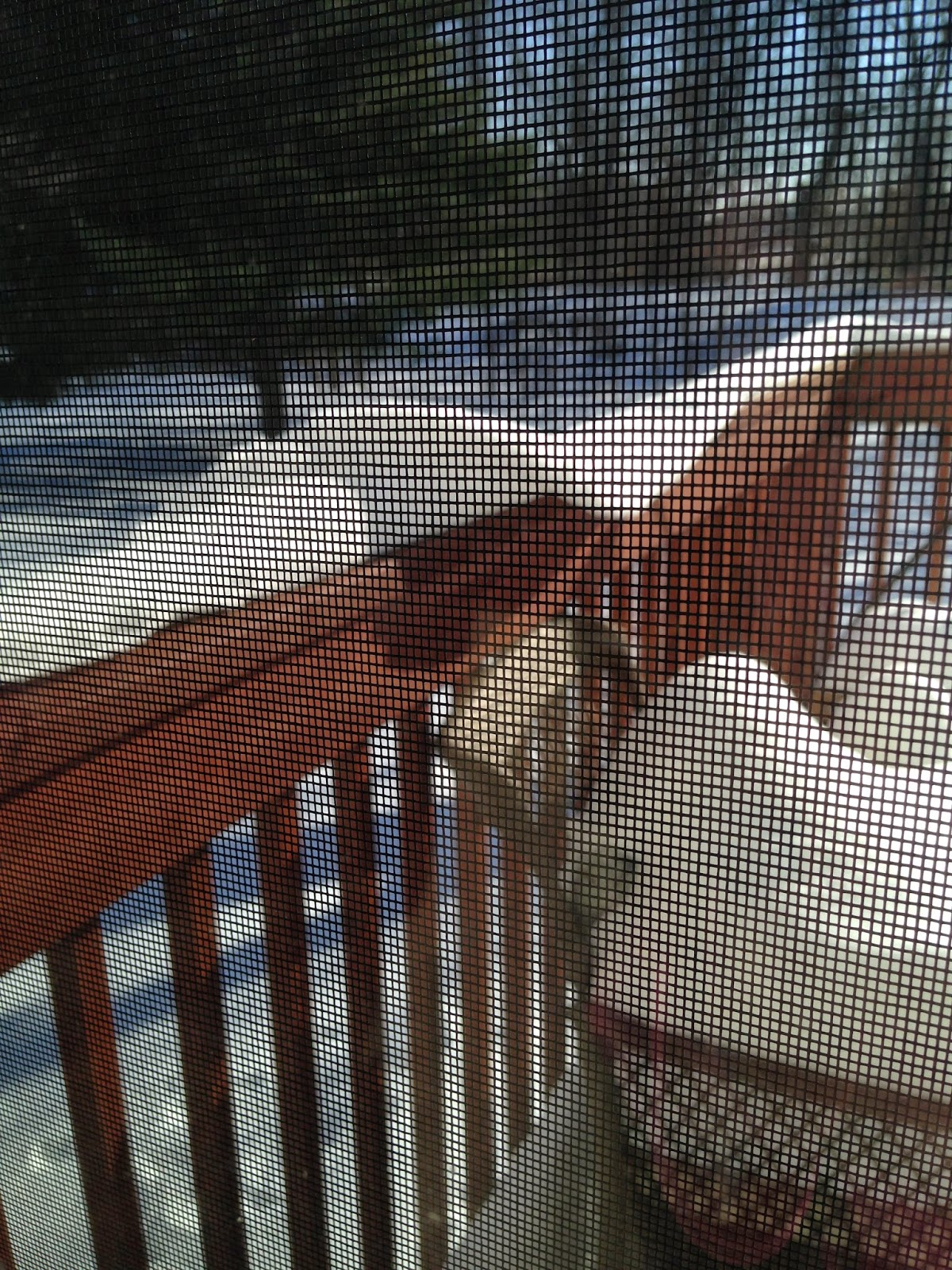 snow collapsing from porch railing