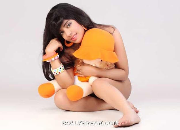 Ankeeta is featured in orange and green bikinis here. She shows off her awesome body and beautiful face in these pics. Welcome to India Ankeeta !!  -  Ankeeta Mukherjee- kajols cousin bikini pics!!!