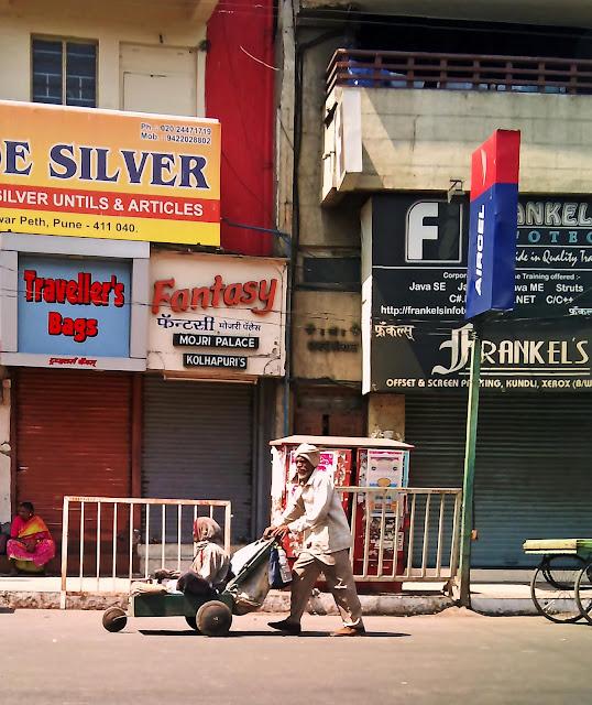 beggar in wheelbarrow in Pune