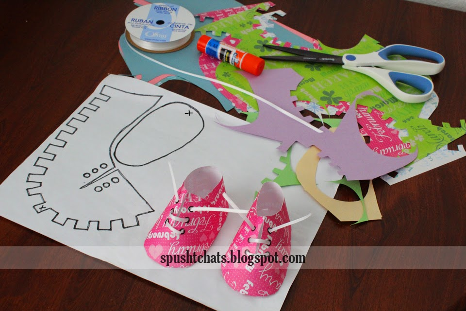 of paper baby shoes , in various colors and some in printed paper ...