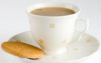 teacup and saucer and digestive biscuit