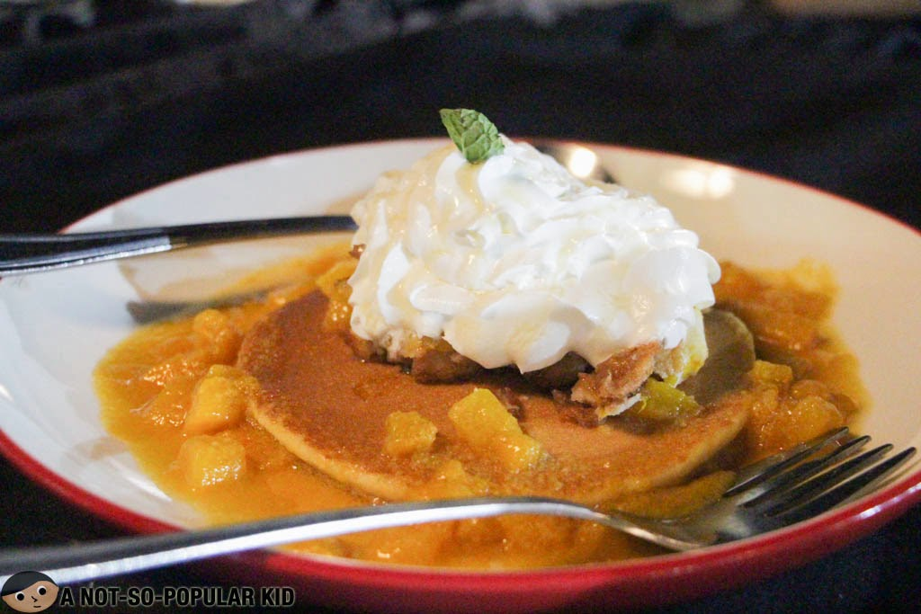 A dessert of Bikers' Cafe - Pancake with Ripe Mangoes and Whipped Cream