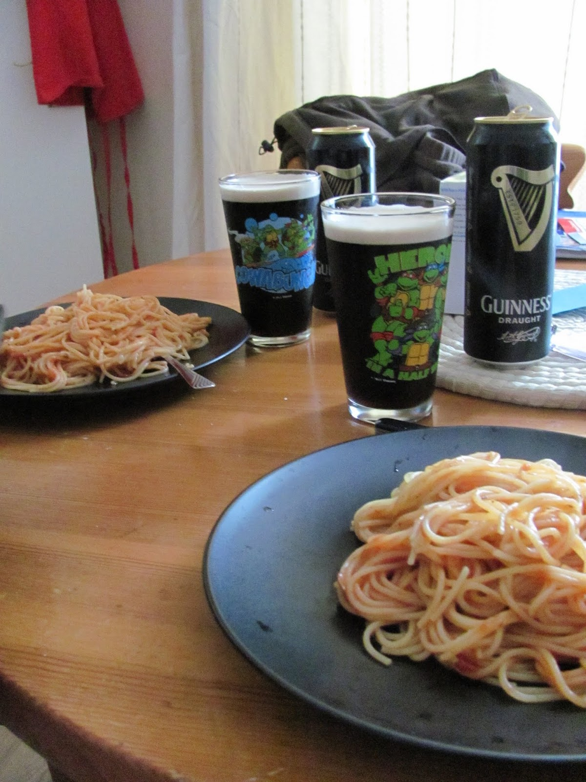 Our first supper in our new home.  Spaghetti on the plates and Guinness stout in Teenage Mutant Ninja Turtles glasses