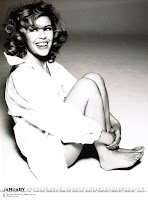 Kylie Minogue black and white picture sitting on the floor