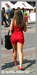 Girl in red shorts on the street