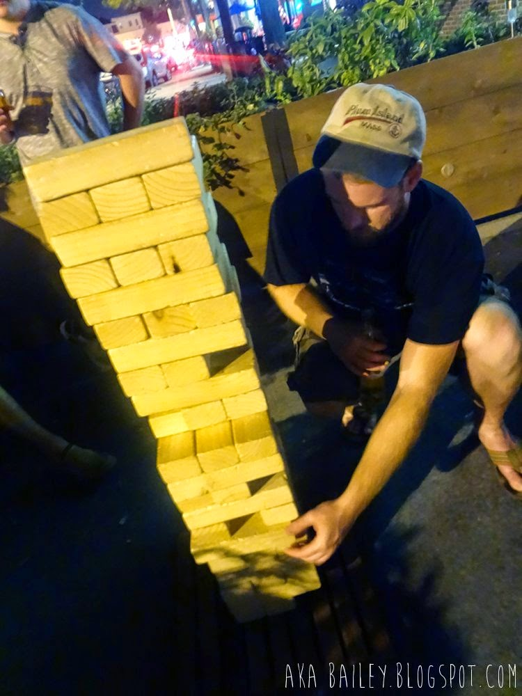Playing Giant Jenga at Brass Union in Somerville