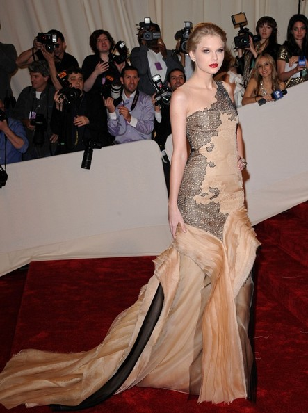 Taylor Swift in a frothy nude and black J. Mendel Couture gown