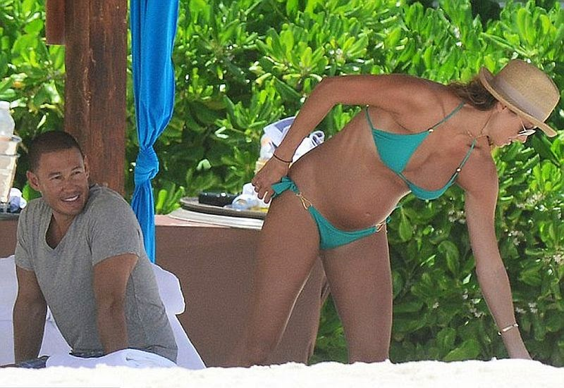 The 34-year-old took her time to relax along the sand with husband, Jared Pobre on Monday, May 26, 2014 in Cancun, Mexico.