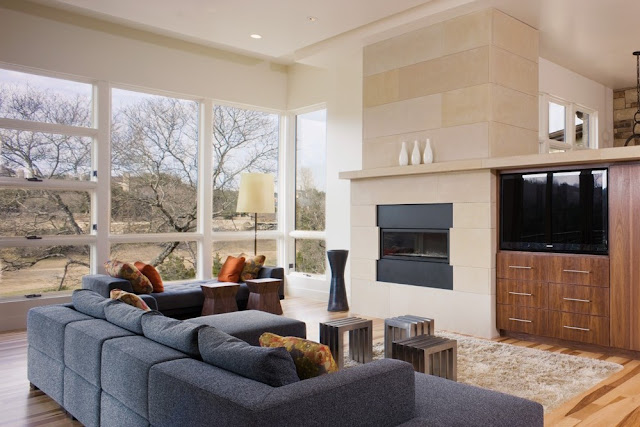 Photo of large modern living room with huge windows and view of the nature