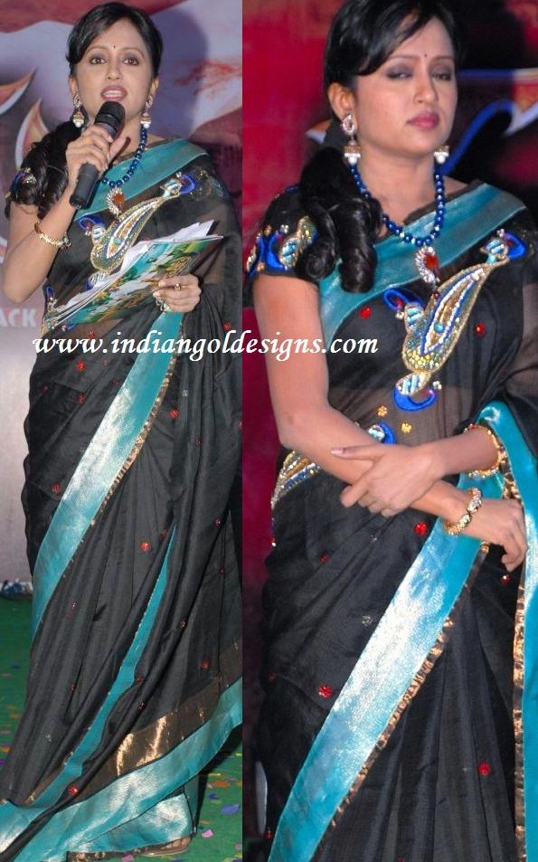 Latest saree designs anchor suma in designer black saree anchor suma in designer black saree altavistaventures Images