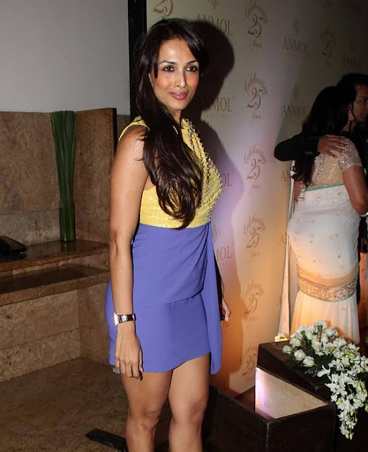 Malaika Arora in Blue Short Skirt and Yellow Top - Indian Fashion Trends Online