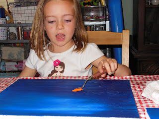 kids paint on canvas