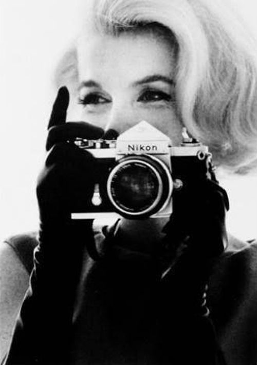 Marilyn Monroe with a Nikon camera by Bert Stern