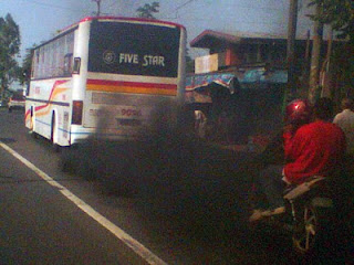 Air pollution in the Philippines. Air polluting bus in the Philippines
