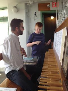 Gabriel and Patrick at keyboard of carillon.