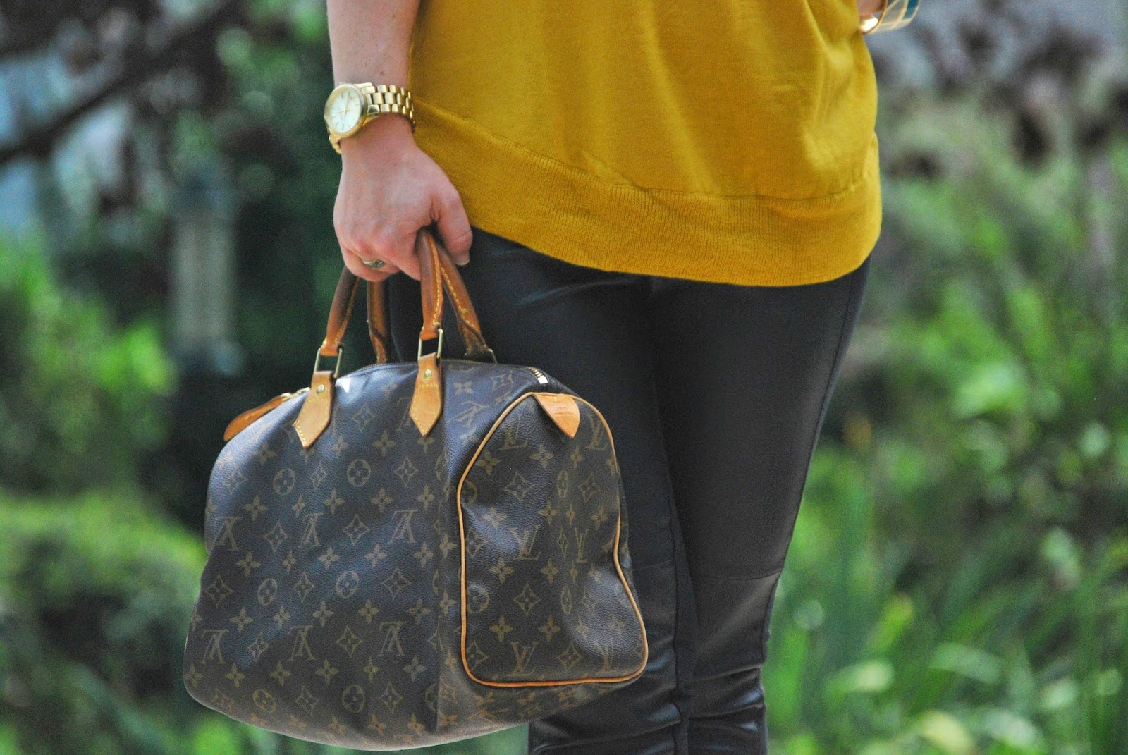 swing sweater, leather pants, christian louboutins, louis vuitton
