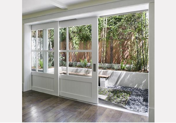 Glamour begins at home born in a barn for Sliding barn doors for patio