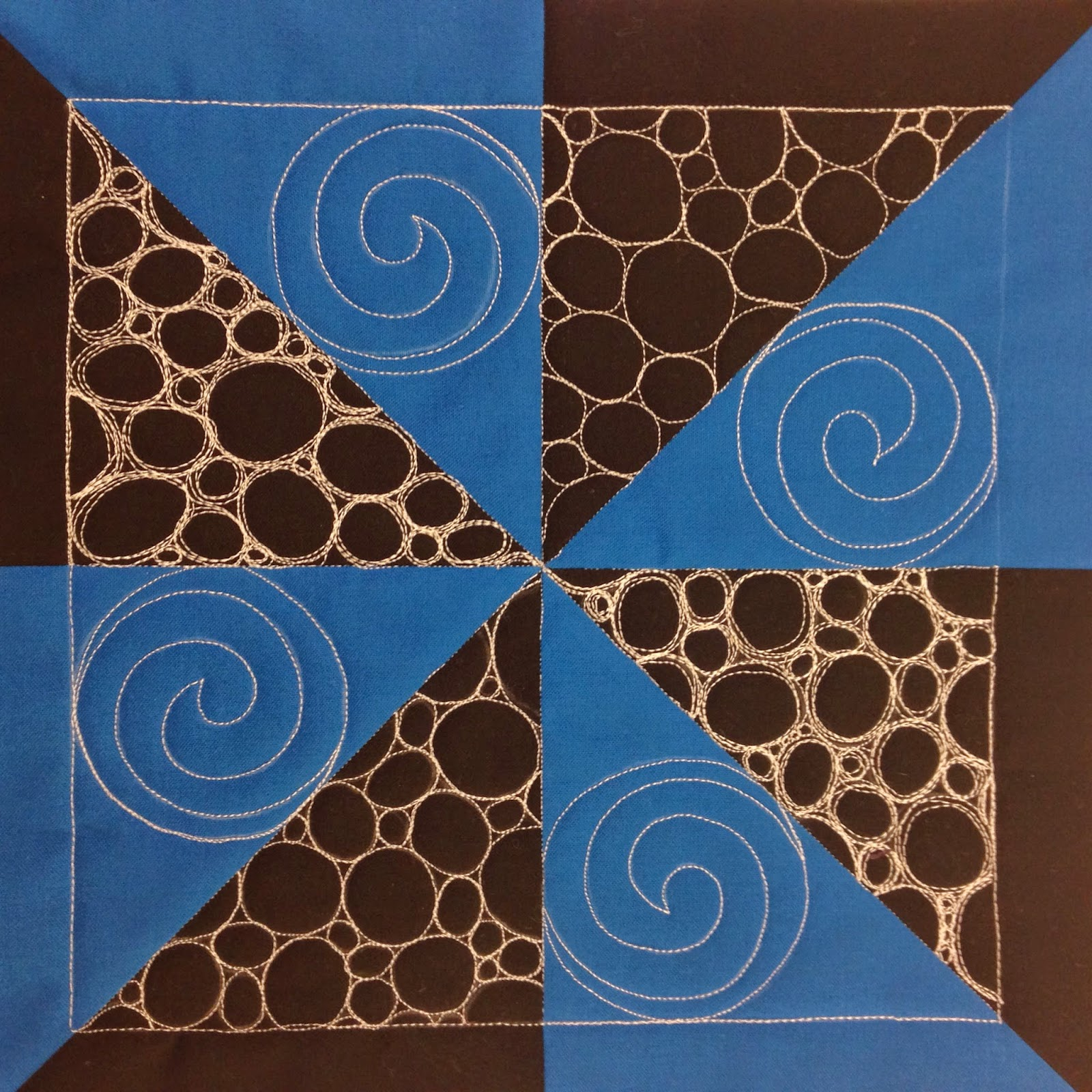 Free Motion Quilting Patterns For Blocks : The Free Motion Quilting Project: 24. Quilt a Pinwheel Block with Spirals and Pebbling