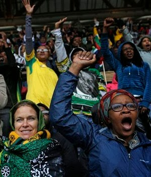 Crowds at the memorial for Nelson Mandela at FNB Stadium. (Bernat Armangue, AP)