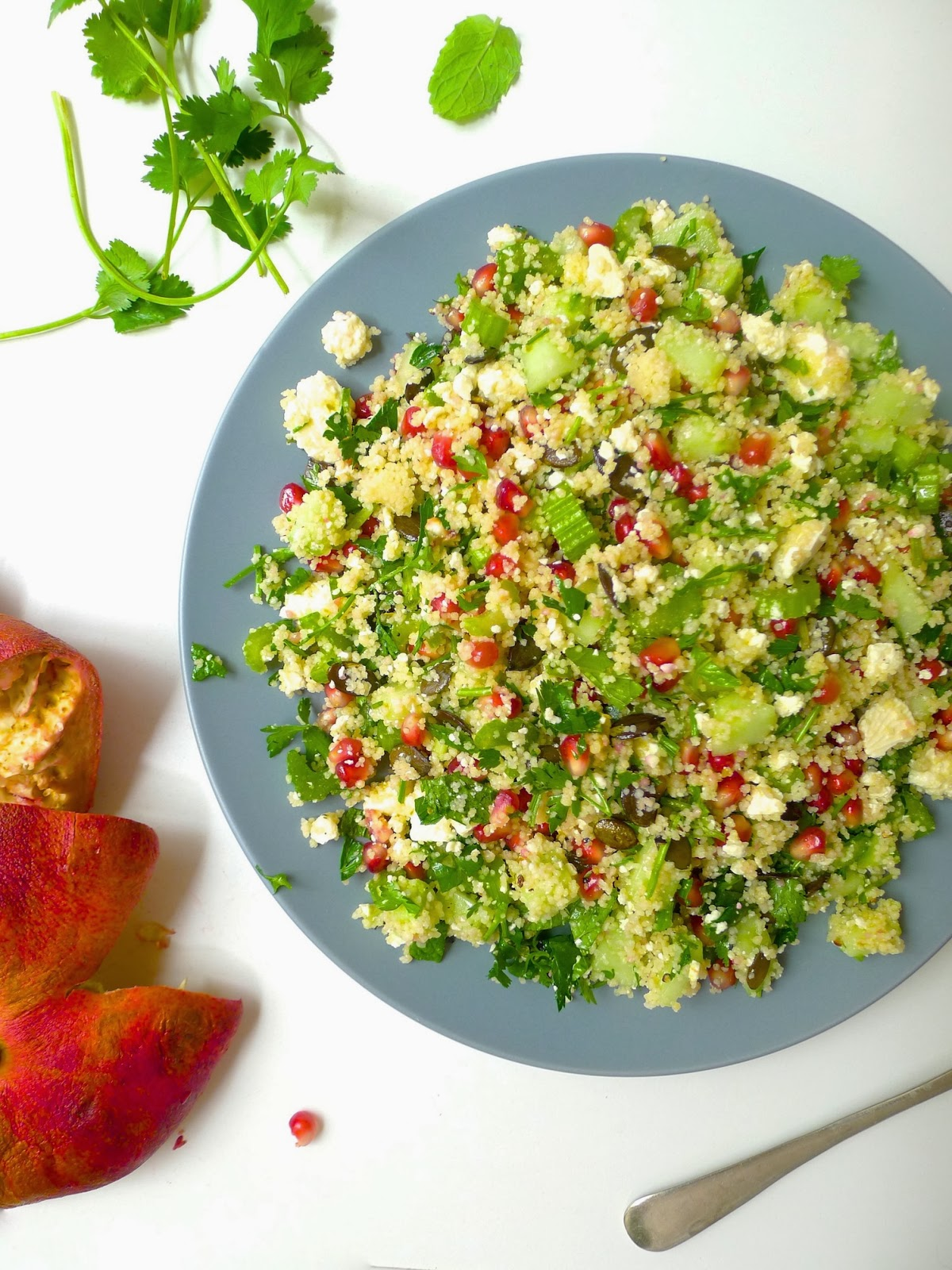 undomestikated pomegranate feta and herb couscous salad