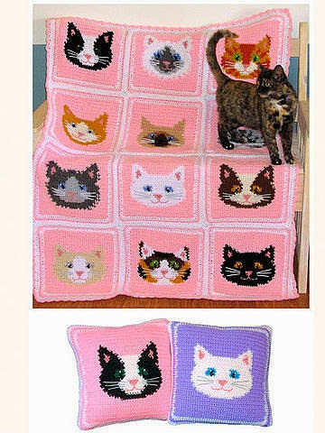 Manta infantil con caras de gatos