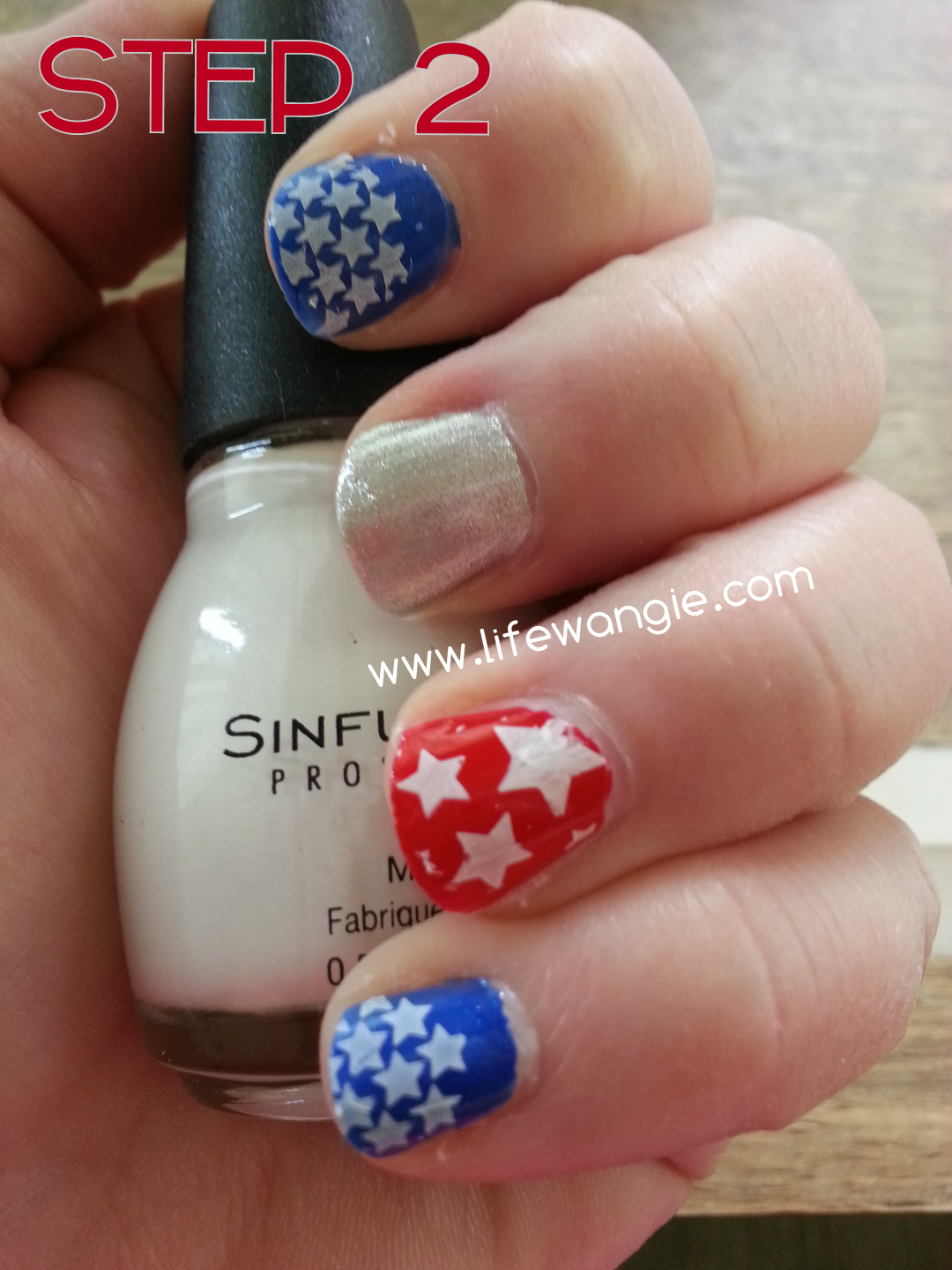 Nails are red, white blue and silver