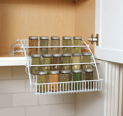 spice rack inside a cabinet; rack pulls down for easy access
