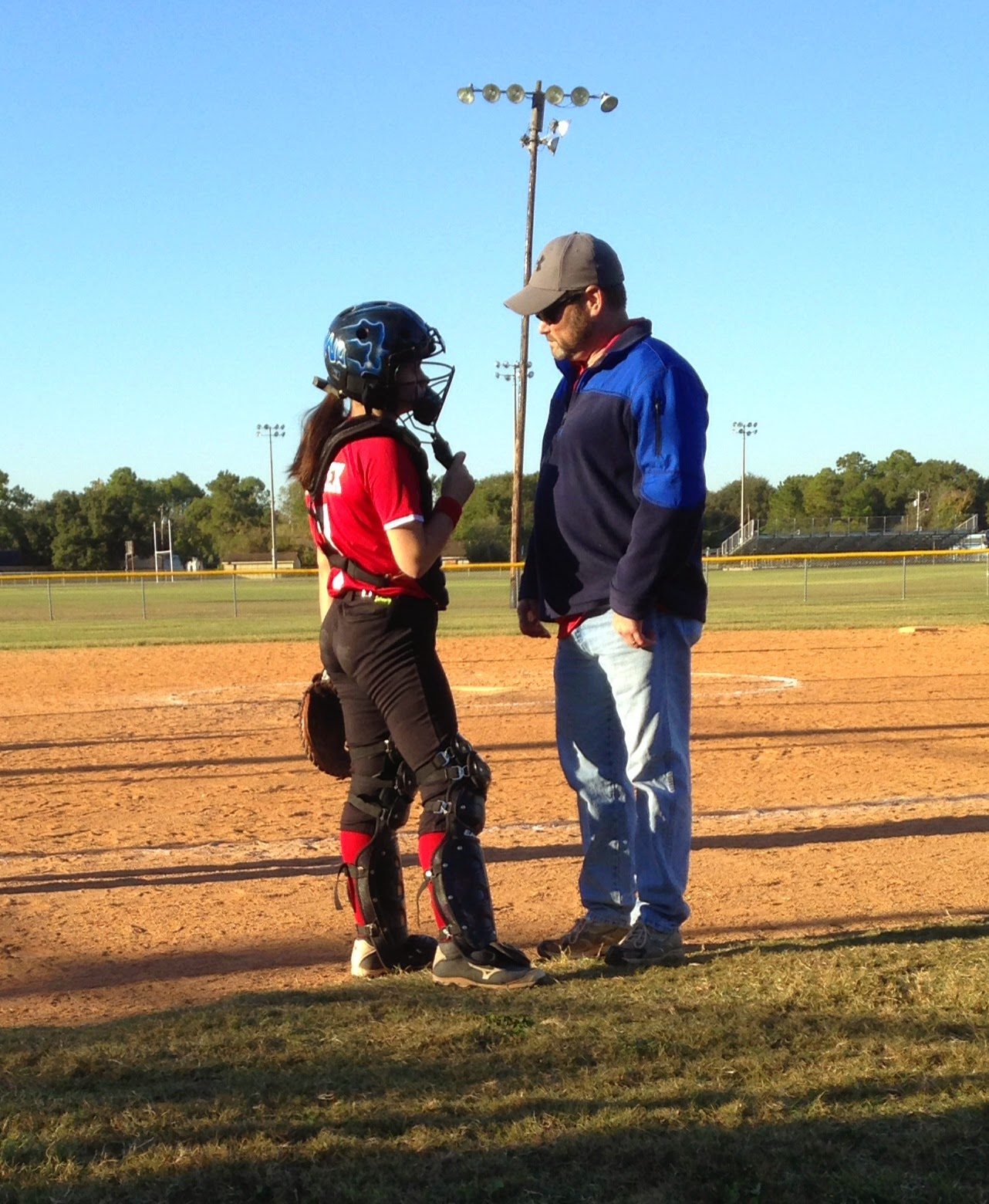 Fastpitch 12U softball catcher coach