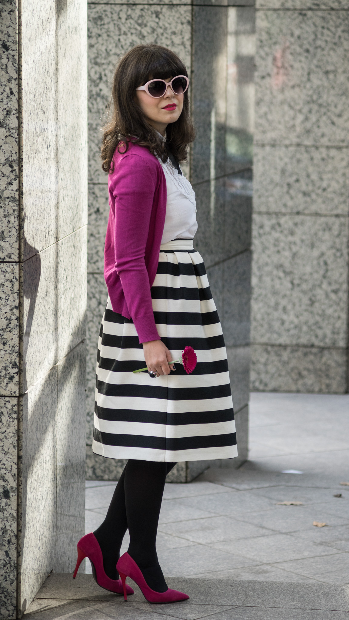black & white outfit with stripes and pops of pink and fuchsia white shirt black bow tie fuchsia shoes heels sweater C&A striped midi skirt stripes pink thrifted trench black clutch pink cat eye glasses