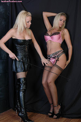 Leather Femdom whipping her pink lingerie slut