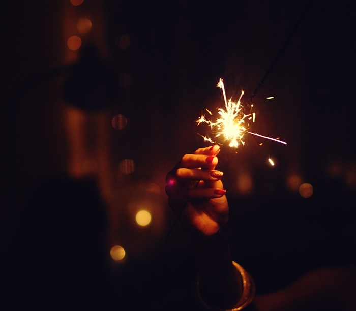 hands and fireworks
