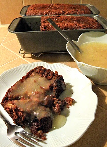 2 Pans of Pudding, Lemon Sauce, and plate with pudding and sauce