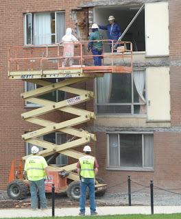 Workers preparing to extract honeybee colony