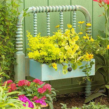 This repurposed drawer painted turquoise makes a charming planter.