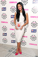 Nicole Scherzinger holding  Cosmopolitan Ultimate Women Of The Year Award