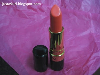 revlon coral berry lipstick. an orange lip colour.