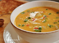 A low-fat creamy corn chowder with chunks of potato and diced red bell peppers for your spoon to scoop up! 