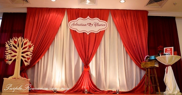 Photo booth backdrop decoration, wishing tree, logo, love, maroon, ivory, satin fabric, draping, red carpet, indian, chinese, sarawakian, red roses, pearls, candle, floating candles, teddy bear, couple, love corner, scallop draping, wishing tags, spotlights, cocktail table