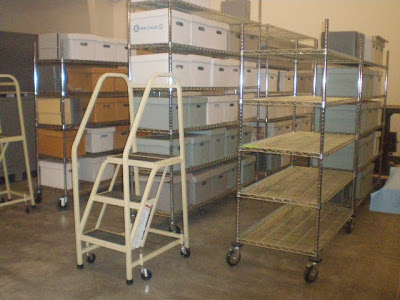 art conservator survey of museum storage space utilization. collection care