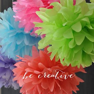 tissue paper pom pom tutorial on Creative Bag's blog