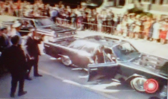 JFK in the bubbletop limo, heading to church