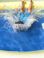 Image of child slipping into pool water: be swimming safety conscious