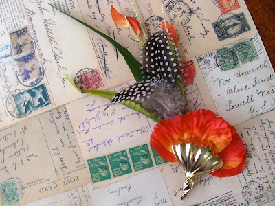 red exotic poppy hair accessory with feathers, grass, and vintage gold