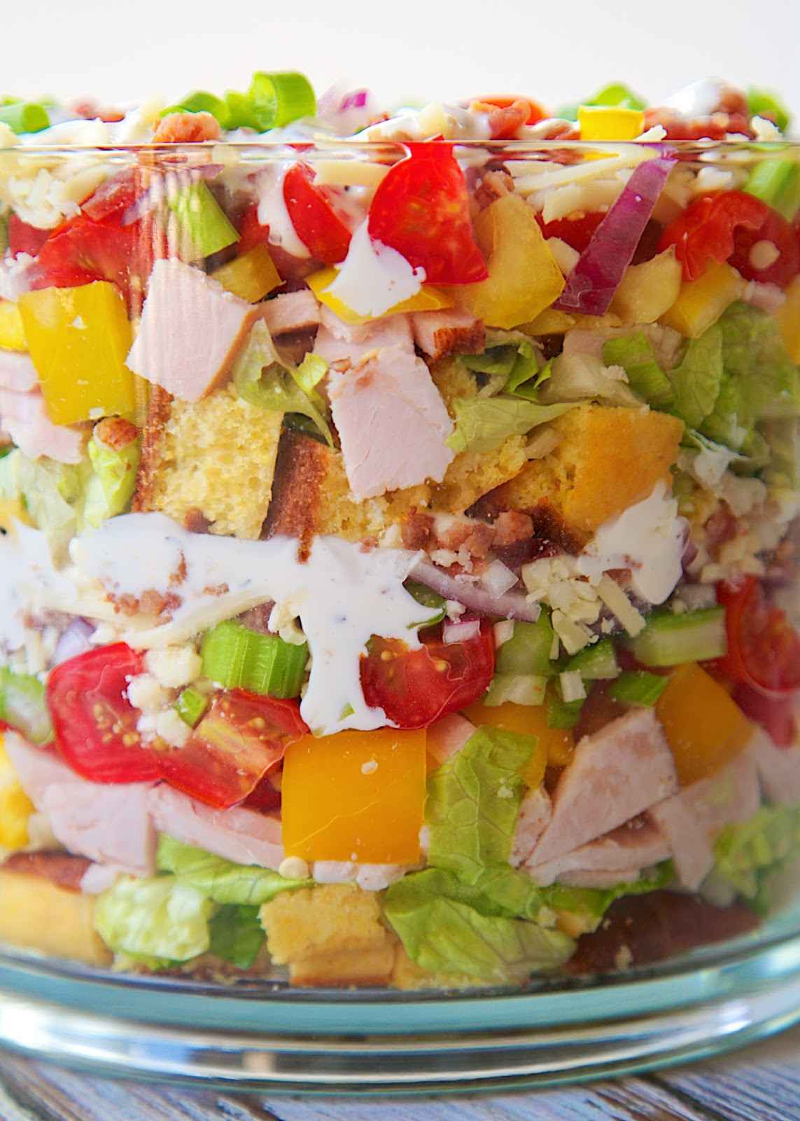 Cornbread & Turkey Layered Salad Recipe - loaded with cornbread, turkey, cheese, vegetables and bacon! It is a whole meal in one big bowl! Make ahead of time and refrigerate before serving. Can be made 24 hours in advance. Perfect for brunch/lunch.
