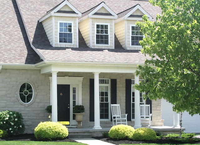 From shack to spectacular house shed dormer porch roof for Landscaping for cape cod style houses