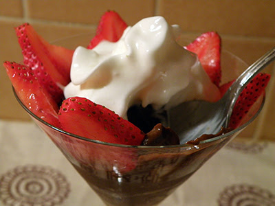 Mousse garnished with Strawberries and Whipped Cream