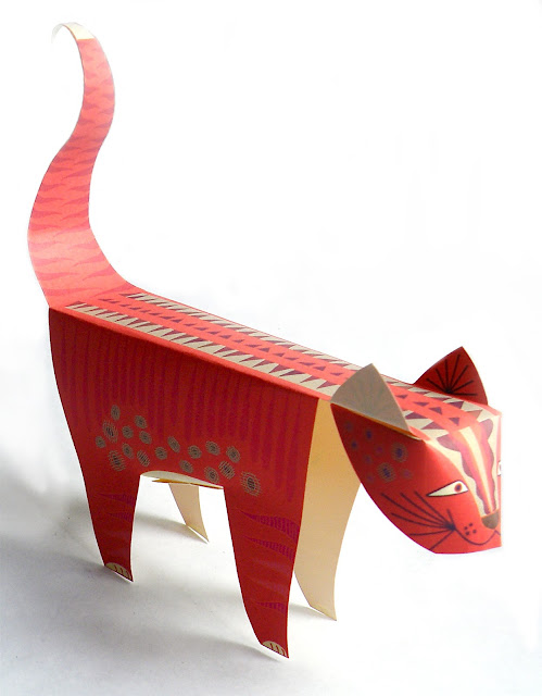 Downloadable paper sculpture of a tiger cat. Cut out fold and glue.
