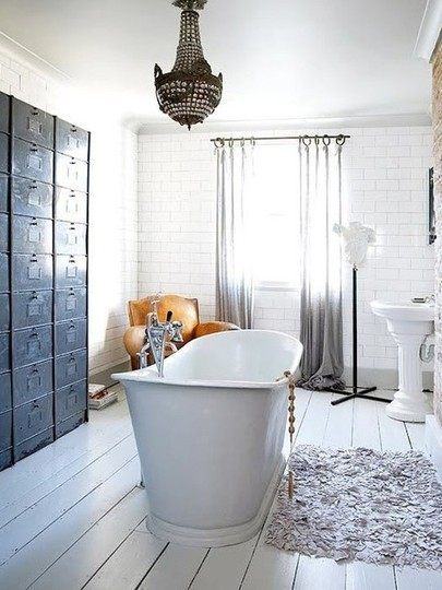 This tub looks so wonderfully deep - and the chandelier above it is a ...
